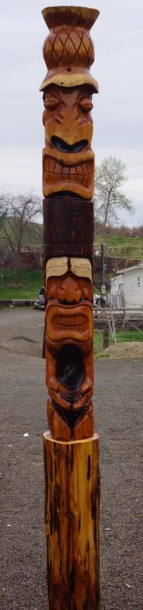 Tiki chain saw carving