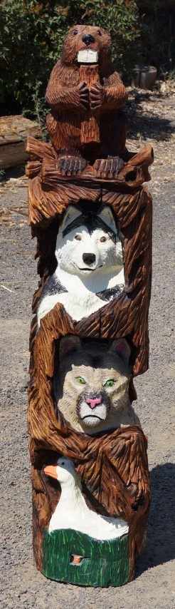 Mascot totem pole chain saw carving