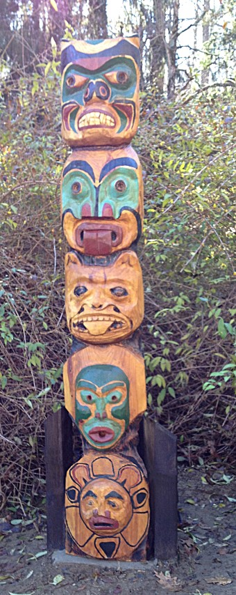 Nw mask totem pole chain saw carving