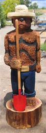 Smokey Bear chainsaw carving