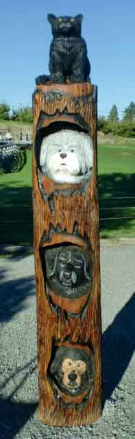 Pet totem  chainsaw carving