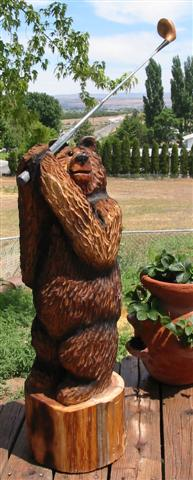 Golfing Bear Carving